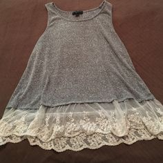 Grey top with white lace trim SUPER CUTE. Used to be one of my favorites. Grey color with white translucent lace design at the bottom, but grey part still covers tummy Forever 21 Tops