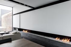 when fireplaces aren't traditional people take notice. how nice to have a gallery wall with the added feature Fireplace Feature Wall, Modern Fireplace, Fireplace Design, Fireplace Wall, Apartment Interior, Interior Walls, Contemporary Interior Design, Cheap Home Decor, Interior Architecture