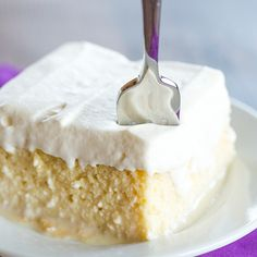 Tres Leches Cake - easy and incredibly delicious! A simple vanilla sponge cake is soaked in a three-milk mixture & topped with fresh whipped cream.