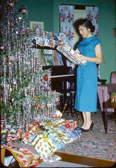 Vintage Christmas....this tree so reminds me of the ones we use to have, just drowning in tinsel....the more the better!