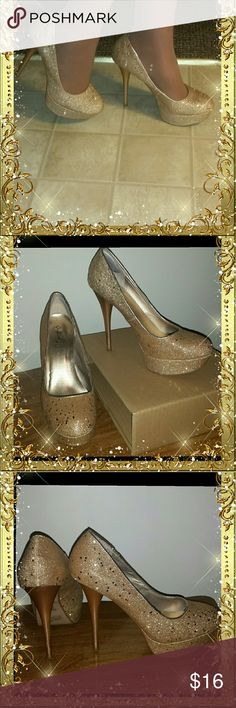 """Golden Shimmer Glitz Stilettos by Cupid These golden babies are to die for, if you love stilettos that you must add these to your collection, I promise you won't be disappointed. Shows some wear on the bottom toe area but nothing major, a size 9,  perfect on the inside, a few teeny scuffs on the heels but nothing too noticeable, 5& 1/2"""" heels, I would classify these in great condition Cupid Shoes Heels"""