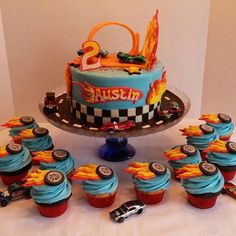 Austin's Hot Wheels cake and cupcakes! 8 inch cake and 2 dozen cupcakes! All candy clay and buttercream, all edible except for the cars which were for the birthday boy to keep! (Cars in these pics were borrowed from my hubby, just for picture taking purposes! lol) #hotwheels #cakes #candyclay #nofondant #cars #toys #nostalgia #angelascakes