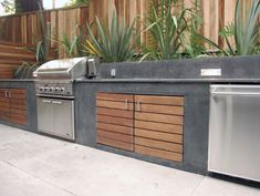 Spa Oasis modern landscape - outdoor kitchen .. nice