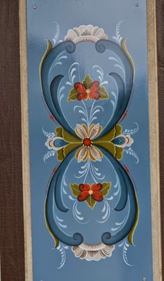 Rosemaling is the term used for the style of decorative painting done in Norway. Description from runnstitch.blogspot.com. I searched for this on bing.com/images
