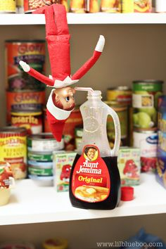 Elf on the Shelf Ideas - Drinking Syrup in Pantry