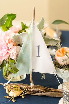 [tps_header] We're always looking for creative and inexpensive DIY wedding ideas and that's exactly why we love driftwood wedding decor. Beach Wedding Tables, Seaside Wedding, Wedding Seating, Wedding Table Numbers, Diy Wedding, Wedding Ideas, Destination Wedding, Elegant Wedding, Nautical Wedding Decor