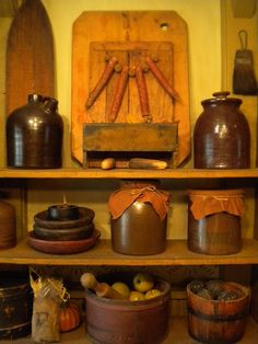 Old Pantry...filled with crocks, buckets, & wooden bowls.