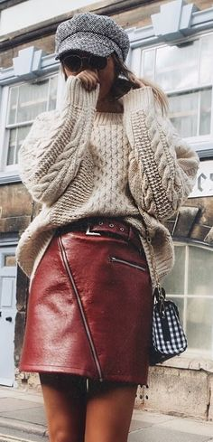 how to style a leather skirt + hat + knit sweater + bag