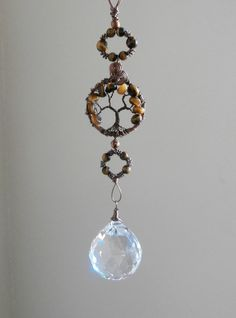 Protection Tigers Eye Tree of life crystal suncatcher with Large crystal ball,  Feng shui cures, window ornament, Free shipping TL1. $36.00, via Etsy.
