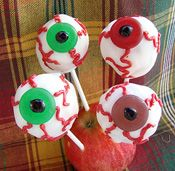 "Another use ofr cake balls! Eyeballs on a stick.Best semi ""creepy"" Halloween food for kids."