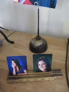 Vintage Oil can picture holder: Just twist up a piece of wire and stick it in the oil can to hold your picture. Also use a vintage folding ruler to hold pics too.
