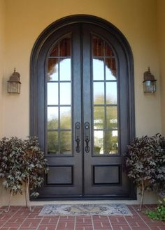 Make an entrance with these iron double doors from Clark Hall. With a grand and timeless design, these custom front doors embody elegance. Arched Front Door, Front Door Entryway, Iron Front Door, Double Front Doors, Arched Doors, Entrance Doors, Windows And Doors, Front Entry, Exterior Windows