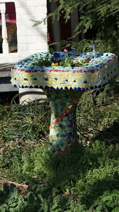 Awesome mosaic sink being used as a planter!