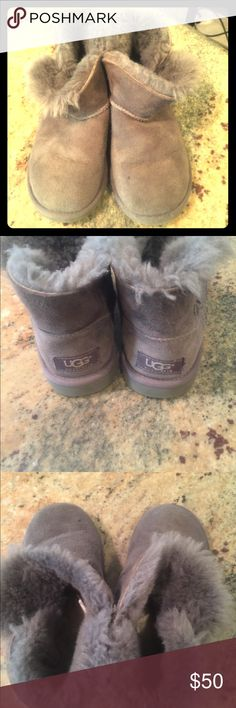 Ugg Mini Bailey Button Boot Grey Sz.1 little girl These cozy Ugg boots have a lot of life left in them.  The two face sheepskin inside them is still fluffy.  The have an Ugg pure wool insole and sheepskin lining.  The suede is a medium grey color.  These are the mini version of the Bailey Button. The shaft only goes above the ankle. They are little girl size 1. UGG Shoes Boots