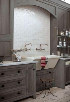 Grey washed cabinets in loft kitchen owned by Jill Brinson of Ballard Design.