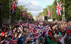Thousands arrived on Sunday to secure a good spot on The Mall, and despite the unseasonable weather they were in celebratory mood for the Jubilee concert on Monday night. Wearing colourful wigs, crowns and Union flags, the crowd nearly drowned out rehearsals as they entertained themselves by singing rousing renditions of songs by JLS and Shirley Bassey.  Picture: Getty Images