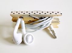 DIY electronic cord keeper project. This is so simple and brilliant and all you need are clothespins and washi tape (optional.)