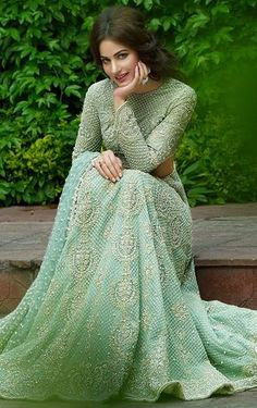 Buy mint green fancy net with precipitant lace work & embroidery work designer lehenga choli online.This set is features a mint green blouse in fancy net fully embellished with resham, embroidery.It has matching mint green lehenga in mint green with b Pakistani Wedding Dresses, Pakistani Outfits, Indian Dresses, Indian Outfits, Bridal Dresses, Pakistani Bridal, Dresses Uk, Lehenga Choli Designs, Lehenga Choli Online