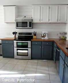 Love the look of this kitchen... Dark bottom cabinets and light upper ones. And the butcher block counter top... ♥