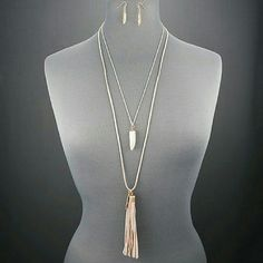 Double Layer Tassle Necklace ad Earrings Bohemian style, pink leather long chain, white and gold shorter chaon. Gold leaf earrings. Jewelry Necklaces