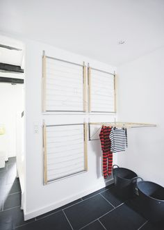 four wall mounted drying racks (from Ikea!) to create an instant indoor drying room - super great space saving idea {remodelista} Laundry Room Design, Laundry In Bathroom, Small Laundry, Ikea Laundry Room, Doing Laundry, Laundry Room Ideas Garage, Ikea Mudroom Ideas, Basement Laundry Rooms, Compact Laundry