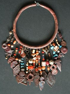 Necklace | Joss Bulk.  Fimo (polymer clay) torque and charms, combined with a few shells, beads and stones.
