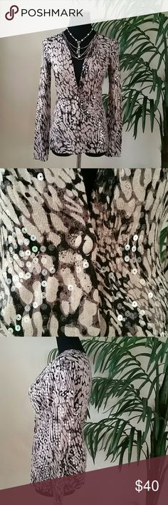 """Gorgeous Animal Print Sequin Cardigan! NWOT Gorgeous Animal Print Sequin Cardigan!  Body hugging fit 80% rayon, 20% nylon, machine wash. One button closure at waist. Clear sequins throughout make a little shimmer wherever you go!  NWOT I never wore it. My loss is your gain. Grab it!  Lay flat measurements: Length 23"""", Bust 17"""", Waist 13"""", Hip 18.5"""" Does stretch!   🚫No Trades 🙄😘  🔘Use OFFER button to negotiate👍🤑 🔘Please Ask ❓'s BEFORE you Buy🤔😃 💕Thank you for stopping by! Happy…"""