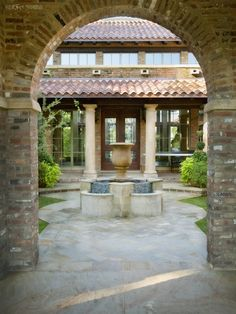 spanish style courtyard with used brick columns, fountains, stone patio, columns and tiled roof