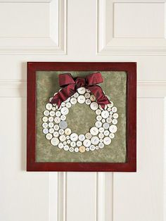 Cute-as-a-Button Wreath        Gather white buttons from your stash and sew them onto fabric to make a wreath that's suitable for framing.    Learn more about this project.    http://www.bhg.com/christmas/crafts/cute-as-a-button-wreath/