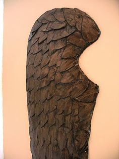 Wings made from cardboard and paper mache.