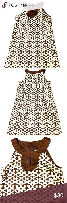"Ann Taylor Shift Dress Sleeveless brown short key Ann Taylor Shift dress Size 4 Fully lined back zipper key hole  Cream/ivory with brown design and collar 100% Cotton  Measurements: Armpit to armpit 18"" Length from armpit down 27"" Smoke free home FAST SHIPPING!!! Ann Taylor Dresses Mini"