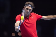 Roger Federer of Switzerland stretches for a backhand in the singles semi-final match against Stan Wawrinka of Switzerland on day seven of the Barclays ATP World Tour Finals at O2 Arena on November 15, 2014 in London, England.