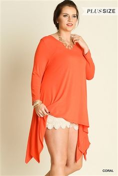 UMGEE Plus Coral Sharktail Tunic Top with Lace Detail This stylish Bohemian long sleeve stretchy knit top in soft coral is ideal for anytime wear. This top is an A-line style with a wide flared hem in a shark tail cut. The back yoke is accented with lace. XL-2X
