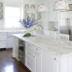 Carrara marble counter, white cabinets , dark floor look for master bath