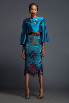 Maxima & Ines – Azure cropped 'Kimo-Buba' and Azure pencil skirt. Skirt is patterned with Komole Kandids Clover motif.