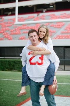 engagement shoot..love the idea of the college football theme :)