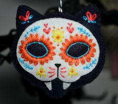 Hand embroidered cat skull for Day of the Dead decorations, altars or shrines.