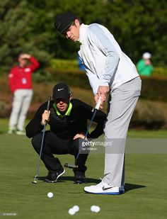 Rory McIlroy of Northern Ireland (L) and Niall Horan look on during the Pro-Am ahead of the BMW PGA Championship at Wentworth on May 20, 2015 in Virginia Water, England.
