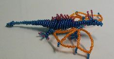 Free detailed tutorial with step by step photos on how to make a dragon out of seed beads and wire in the technique of 3D beading. Great for beginners!