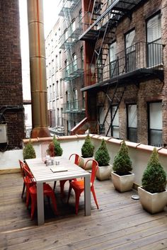 Even in the shade of taller buildings, small rooftop patios can still make for the perfect little hideaway.