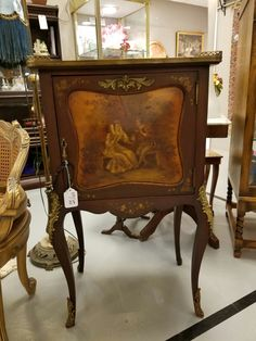 Beautifully decorated cabinet.  Visit Gaslamp Antiques booth B318.
