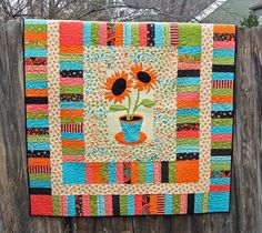 Sunflower Applique Quilt or Wall Hanging by ColoradoQuilts on Etsy. $170.
