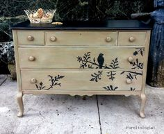 tan dresser with back bird
