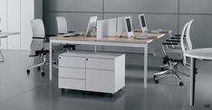 OT. Group of 4 desk set up with oak tops on slim metal frame.