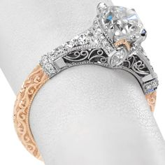 The stunning cushion cut center is a fashioned in this exquisite antique inspired setting. The shine of the white metal is decorated with brilliantly faceted diamonds while the warmth of the rose gold is adorned with relief hand engraving. #knoxjewelers #ring  www.knoxjewelers.biz