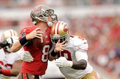 Description of . Aldon Smith of the San Francisco 49ers sacks Mike Glennon of the Tampa Bay Buccaneers during a game at Raymond James Stadiu...