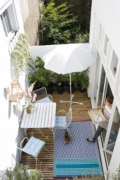 Small patio space with umbrella
