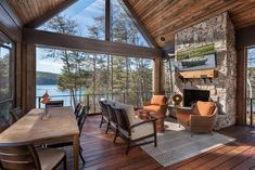 A rustic lakefront retreat by design-build firm Dillard-Jones Builders is located on the shores of Lake Keowee, in beautiful South Carolina. House Design, House, House With Porch, Outdoor Living, Custom Homes, Porch Design, Lake House, Rustic Porch, Building A Porch