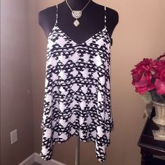 Black & white top Black & white Mossimo top. Sexy back w longer sides. And adjustable strapes! Great w leggings or skinny jeans! Mossimo Supply Co Tops