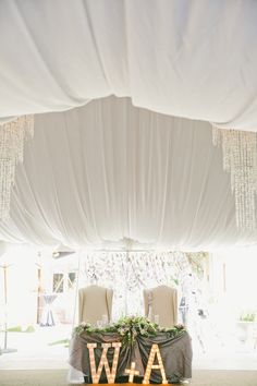 Charming DIY Garden Wedding by Onelove Photography #lighting, #sweethearttable, #draping, #marqueelights